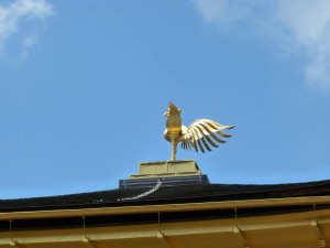 A golden statue of a bird which invites happiness.