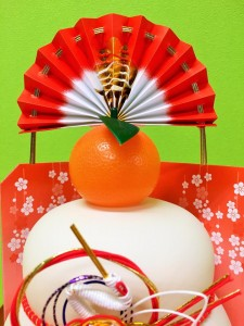 "We put a bitter orange (or a mandarin orange) on the top of the ""Kagami-Mochi"". And display a fan behind. Orange's meaning: Mascot in hope of longevity and prosperity of family. Fan's meaning: A wish to proper for a long time is wished to a fan."