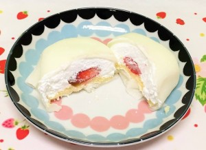 Stuffed with whip cream, strawberry, and a sponge.