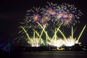 Fireworks are set off over at night.