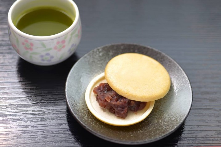 """Monaka"" (bean jam filling wafers) with green tea."