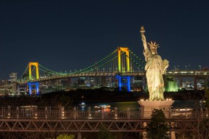 Rainbow bridge and STATUE OF LIBERTY at night.