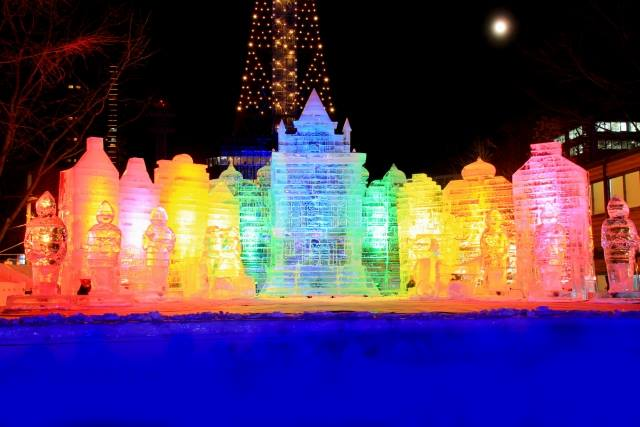 Beautiful ice object lighted up rainbow.