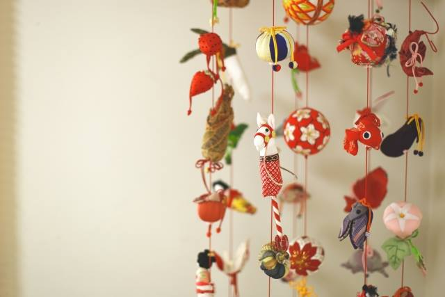 """Tsurushi-bina"" is hanging small dolls made from clothes at red string in Dolls' festival."