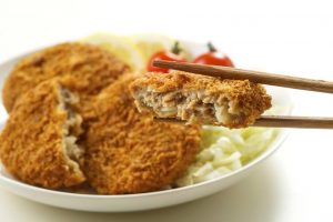 """""""Menchi-katsu"""" is a breaded and deep-fried ground meat cutlet."""